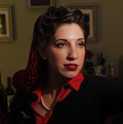 40's war time head shot with red snood and victory rolls